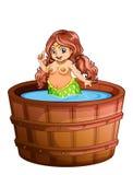 En fet sjöjungfru som tar ett bad Arkivfoto