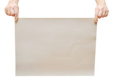 En feuille de gris des mains de l'homme Image libre de droits