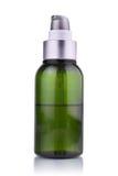 En flaska av kräm Arkivfoto
