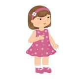 En flicka i en rosa klänning Arkivfoton