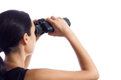 En flicka och ett par av kikare Arkivbild