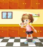 En flicka som äter klubban Arkivfoto
