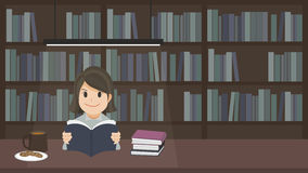 En flicka som läser en bok Royaltyfri Bild