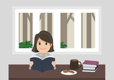 En flicka som läser en bok Arkivbild