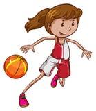 En flicka som spelar basket Arkivbild