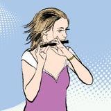 En flicka som spelar flöjten Fotografering för Bildbyråer