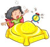En flicka som vaknar upp med ett larm Arkivfoto