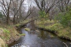 En flodvisningnedgång i Midwesten royaltyfri bild