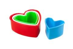 En forme de coeur en plastique coloré multi d'isolement Photographie stock libre de droits