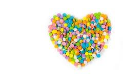 En forme de coeur fait à partir de coloré arrose Photographie stock libre de droits
