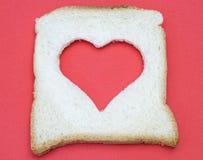 En forme de coeur sur le pain Image libre de droits