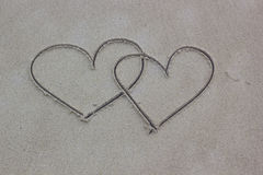 En forme de coeur sur le sable Images libres de droits