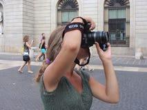En fotograf som tar bilden Arkivbild