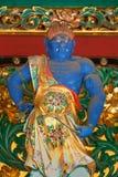 En förmyndare på den Yashamon porten på den Taiyuinbyo relikskrin Arkivbilder