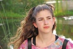 En fundersam tonårig flicka Royaltyfri Bild