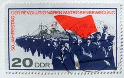 En gammal öst - tysk portostämpel som firar den tyska sjö- revolten av 1917 Arkivbild