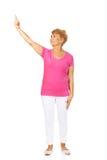 En gammal lycklig dam som pekar för något Fotografering för Bildbyråer