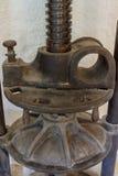 En gammal olivgrön press från en mala i nordliga Korsika Royaltyfri Fotografi