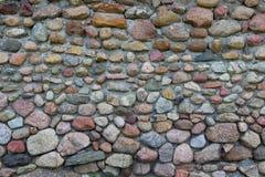En gammal stenblockstenvägg Arkivbilder