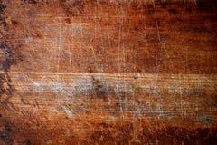 En gammal träskärbräda arkivbild