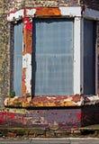 En gata av stigit ombord upp övergivna hus Royaltyfri Foto