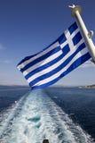 En grekisk flagga i det Aegean Royaltyfri Foto