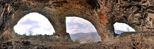 En grotta med tre ingångar Arkivfoto