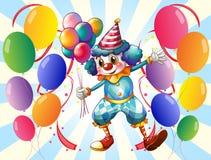 En grupp av ballonger med en cirkusclown Arkivfoto