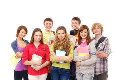 En grupp av unga tonåringinnehavanteckningsböcker royaltyfria bilder