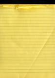 En gul anteckningsbok Royaltyfri Bild