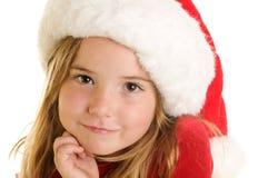 En gullig liten flicka i en Santa Claus Hat Arkivbild