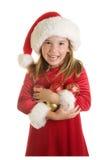 En gullig liten flicka i en Santa Claus Hat och en julklänning Royaltyfria Bilder