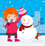En gullig liten flicka och snögubbe Royaltyfria Foton