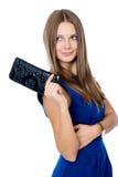 En härlig kvinna med en svart handväska Fotografering för Bildbyråer