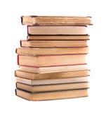 En hög av gamla böcker som isoleras på vit bakgrund Samling Royaltyfria Foton