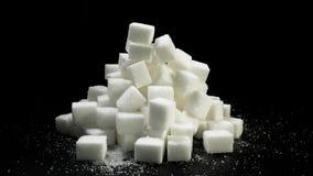 En hög av sockerstycken lager videofilmer