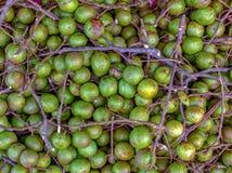 En hög av spanska limefrukter arkivbild