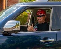 A senior man wearing a Trump 2020 hat at Pro Trump Boat Parade