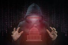 En hacker som använder ransomware för attackregeringsystem royaltyfri bild
