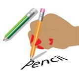 En hand som rymmer en blyertspenna Arkivfoton