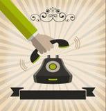 En hand - välj upp en telefon med retro stil Royaltyfria Bilder