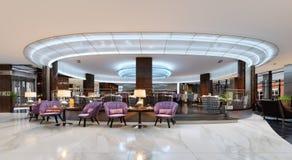 En hemtrevlig kafeteria i lobbyen med bekväm stoppad stol vektor illustrationer
