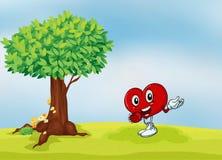 En hjärta och ett träd Fotografering för Bildbyråer