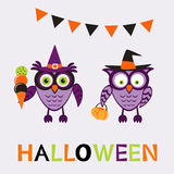 En illustration av gulliga halloween ugglor Arkivbild