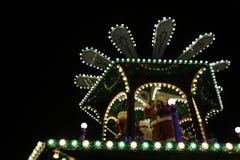 En julkarusell med jultomten Royaltyfri Bild