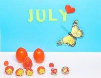 En kalender av månaden av Juli Arkivfoto