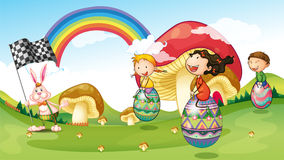 En kanin och ungar med easter ägg Royaltyfri Foto