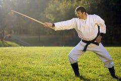 En kimono con la espada de madera Fotografía de archivo