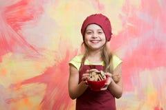 En kinderjaren en geluk die, die eten koken, stock fotografie