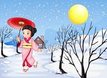 En kinesisk dam som går under snön Royaltyfri Fotografi